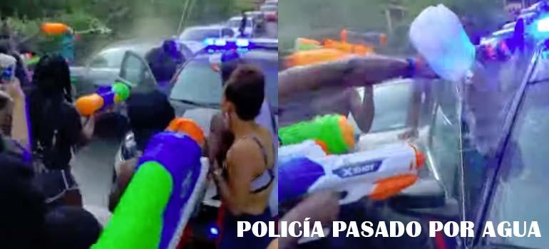 Policía intenta parar una batalla de pistolas de agua y termina empapado. 11