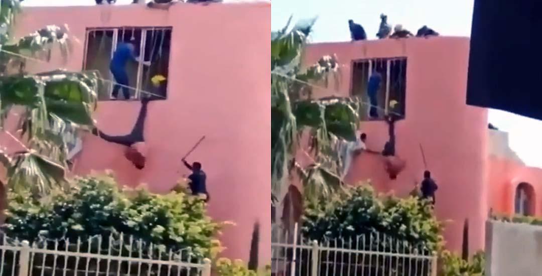 Ladrón queda colgado de una ventana y los vecinos lo quieren linchar. 6
