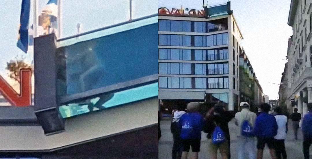 Pareja grabada en la piscina de cristal del hotel. Vídeo. 3