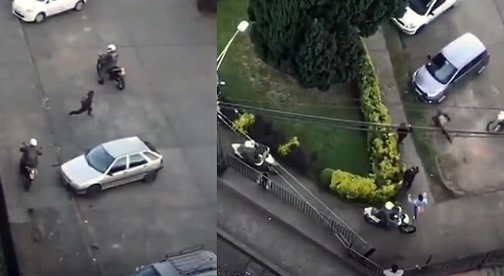 Manifestante Chileno escapando de 5 policías en moto 6