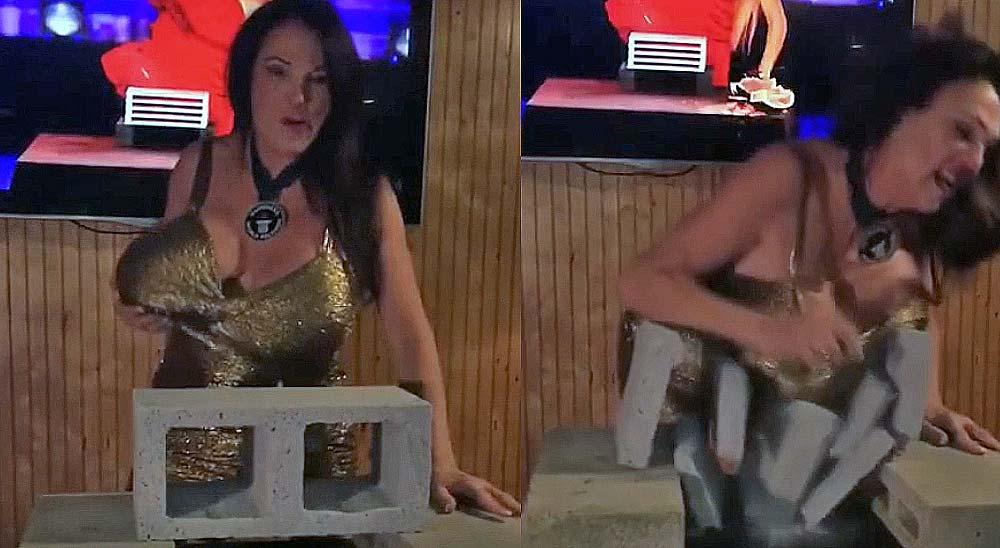 Esta mujer rompe un bloque de cemento con el pecho 6